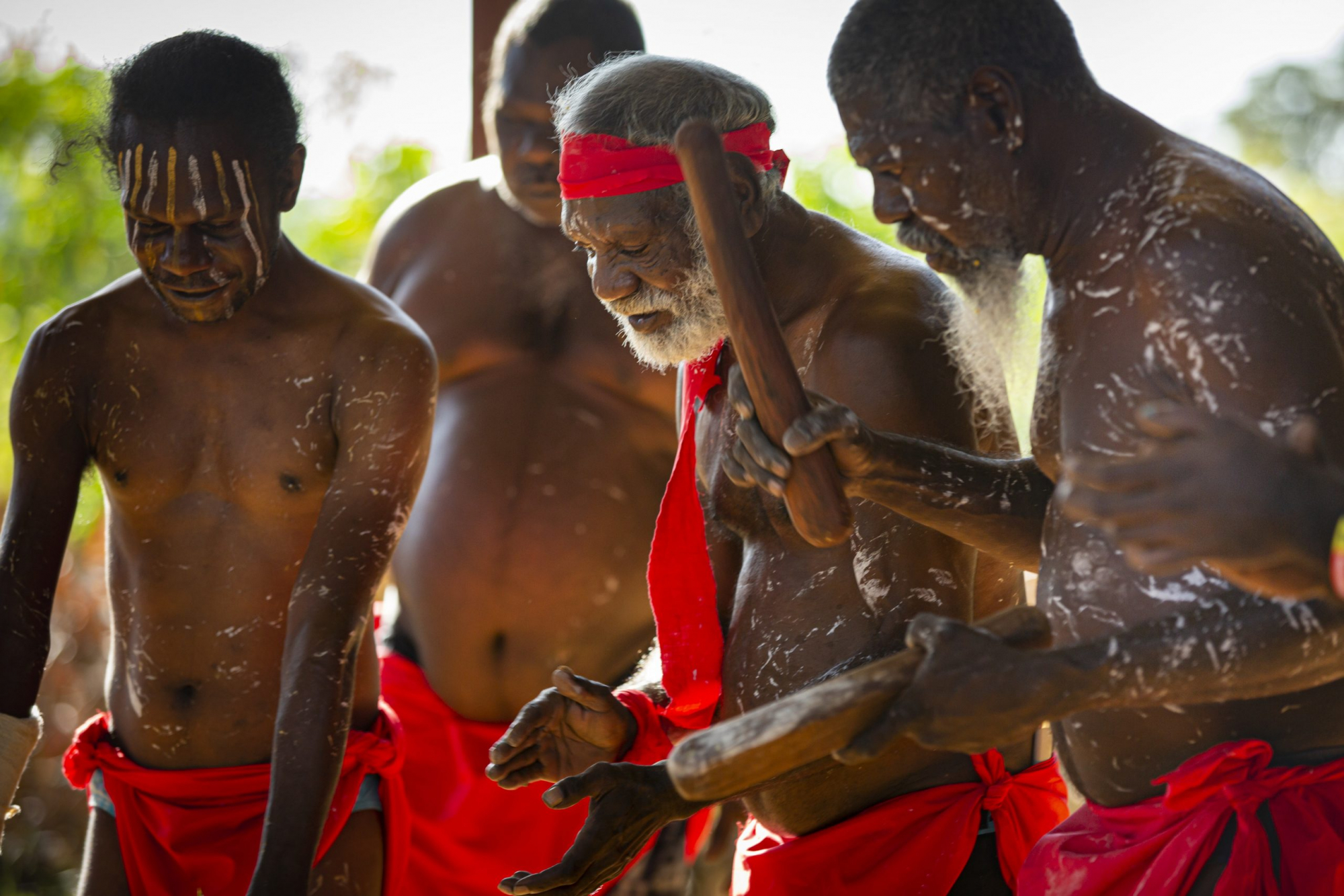 Kakadu & Tiwi Islands Explorer | Aboriginal men performing a traditional dance, Tiwi Islands, Top End, Northern Territory