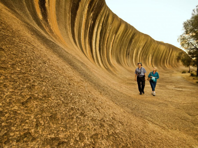 Wave Rock, York, Wildflowers & Aboriginal Experience   Couple at Wave Rock