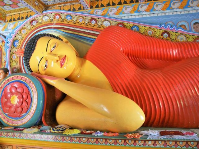 Sri Lanka with Uga Escapes | Reclining Buddha Statue at Isurumuniya Vihara, Anuradhapura, Sri Lanka