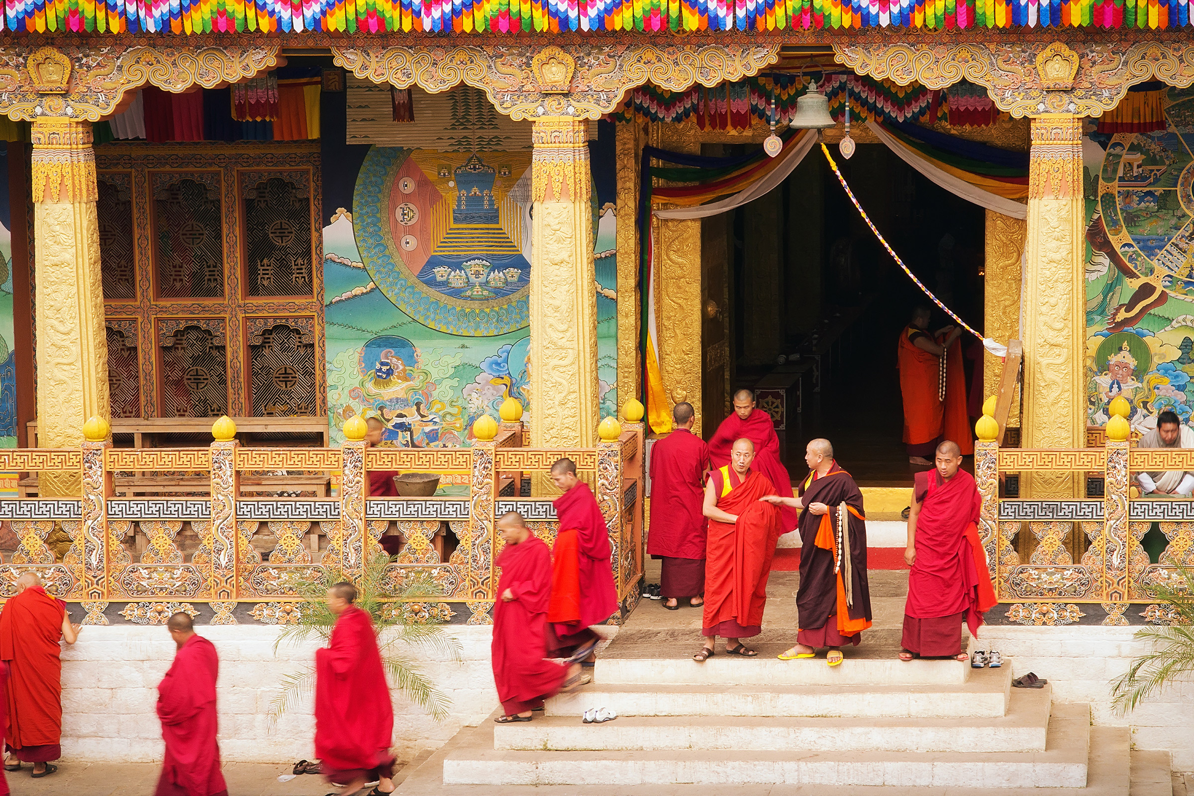 Himalayas of Tibet - Tibetan monks leave an old buddhist monastery temple after prayer, Lhasa, Tibet